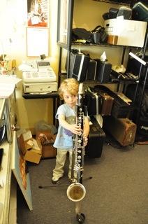 Park tries out a bass clarinet at Steve Deutsch Woodwinds in Berkeley California