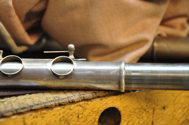 Re-soldering the rib on a vintage Haynes flute.