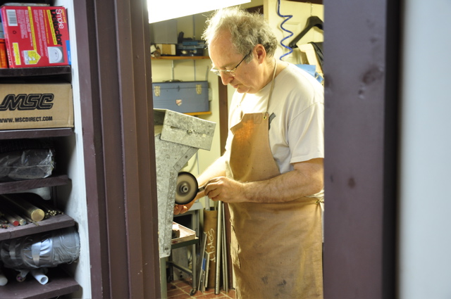 Buffing a flute in preparation for an overhaul.