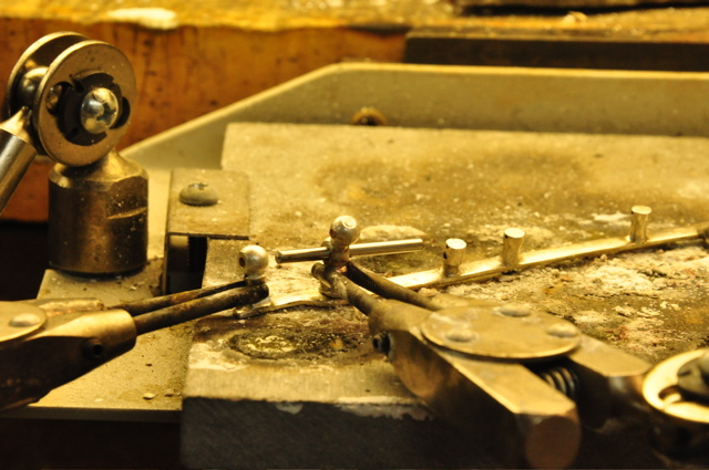 Lining up a flute rod for soldering.