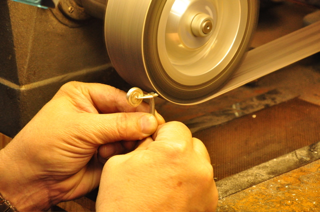 Finishing touches on a flute key repair.