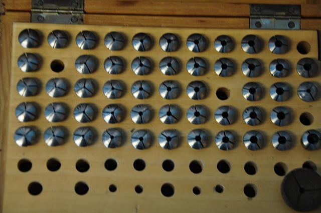Complete set of collets used to hold screws, tools, whatever needs to be held tightly in lathe for flute repair.