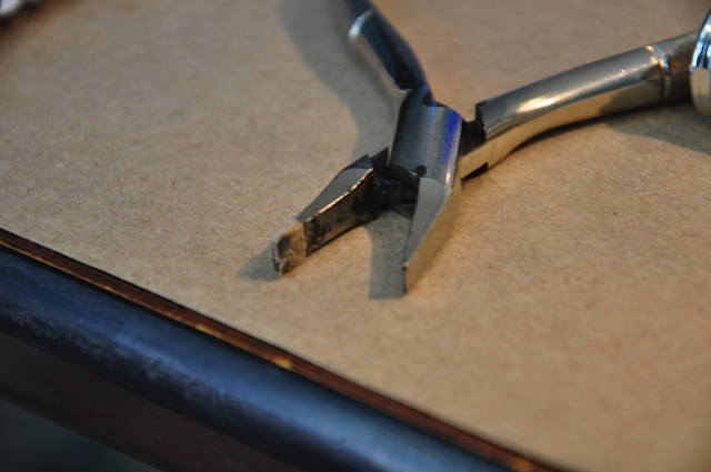 Pliers used for bending flute keys.