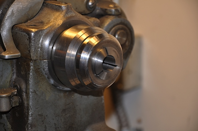 Collet on large lathe for flute repair.